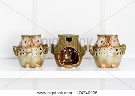 Decorative Green Owl Candles On White Shelf