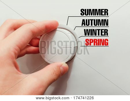 Male Hand Turns The Switch. Switches Seasons. Chose The Spring.
