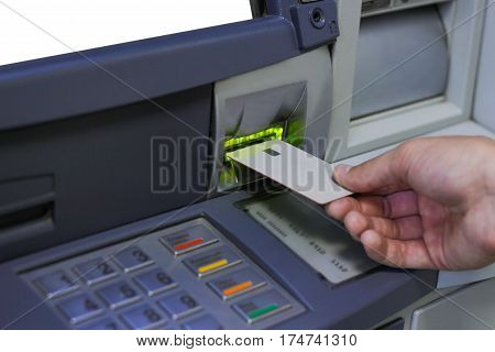 ATM inserting a grey card, close up