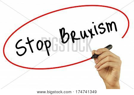 Man Hand Writing Stop Bruxism With Black Marker On Visual Screen. Isolated On Background. Business,