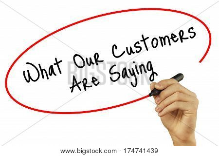 Man Hand Writing What Our Customers Are Saying With Black Marker On Visual Screen. Isolated On White