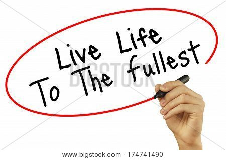Man Hand Writing Live Life To The Fullest With Black Marker On Visual Screen. Isolated On Background