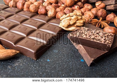 Chocolate Pieces, Filbert, Chocolate Shavings, Walnut On Dark Background