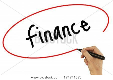 Man Hand Writing Finance With Black Marker On Visual Screen. Isolated On Background. Business, Techn