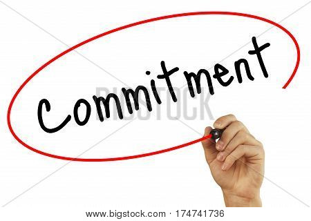 Man Hand Writing Commitment With Black Marker On Visual Screen. Isolated On Background. Business, Te