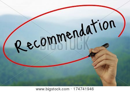 Man Hand Writing Recommendation With Black Marker On Visual Screen. Isolated On Background. Business