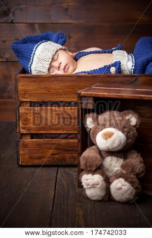 Sweet Little Newborn Inside A Wooden Crate