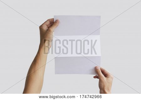 Hand holding blank brochure booklet in the hand. Leaflet presentation. Pamphlet hand man. Man show offset paper. Sheet template. Book in hands. Booklet folding design. Fold paper sheet display read.
