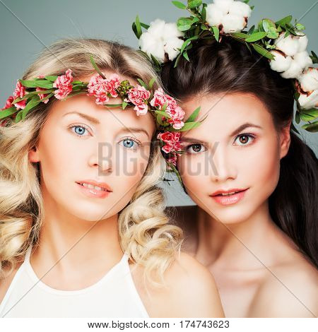 Beautiful Blonde and Brunette Models. Fashion Beauty Portrait of Nice Women with Flowers