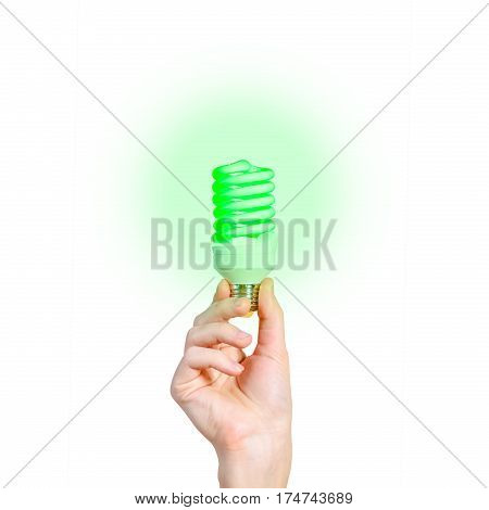 Closeup Of Man's Hand Holding Energy Saving Lamp. Glows Brightly With Green Light. Recycling, Electr