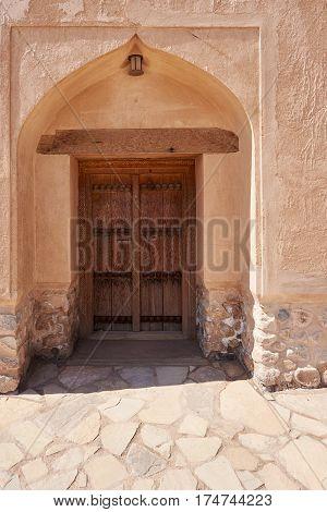 Old Wooden door set in an earthen wall