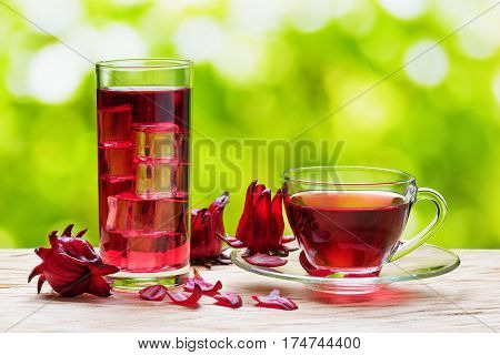 Cup Of Hot Hibiscus Tea And The Same Cold Drink In Glass
