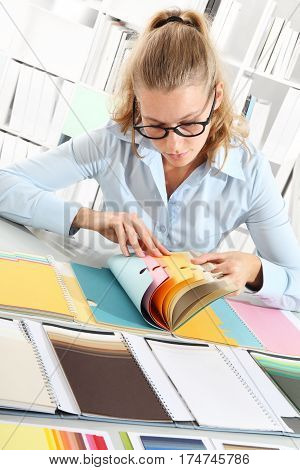 woman choosing color with a colors sampler