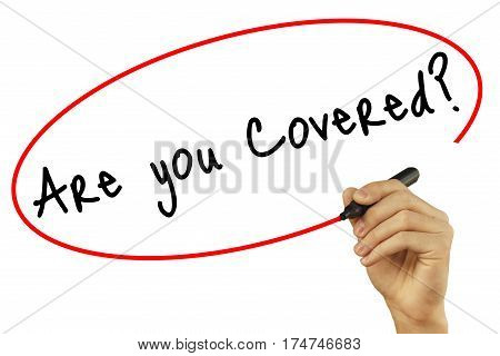Man Hand Writing Are You Covered? With Black Marker On Visual Screen. Isolated On White Background.