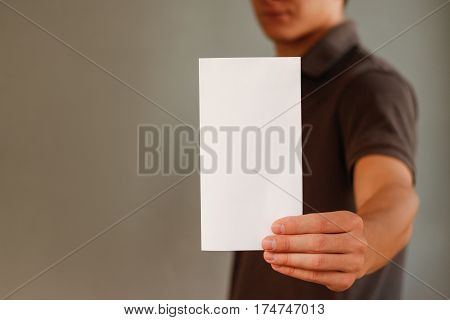Man showing blank white flyer brochure booklet. Leaflet presentation. Pamphlet hold hands. Man show clear offset paper. Sheet template. Booklet design sheet display read first person