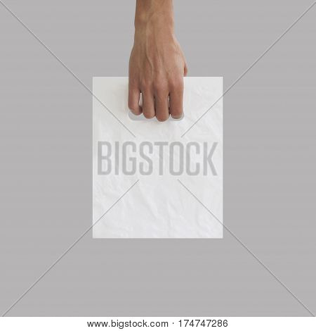 Blank Plastic Bag Mock Up Holding In Hand. Empty Polyethylene Package Mockup Hold In Hands Isolated