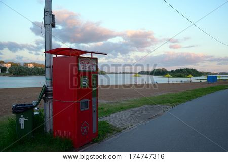 Velikiy Novgorod Russia - July 15 2016: Water dispensers on the Volkhov river beach at sunset