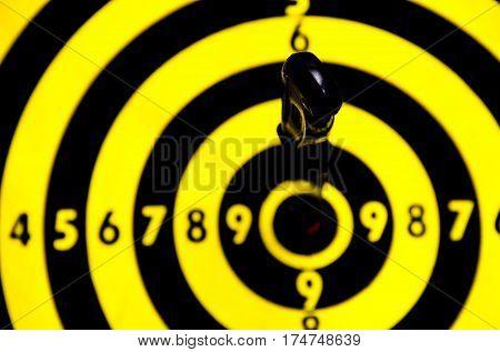 Cogent of business, knife on target dart board, copy space background