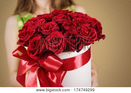 Girl Holding In Hand Rich Gift Bouquet Of 21 Red Roses. Composition Of Flowers In A White Hatbox. Ti