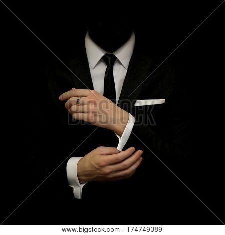 Man In A Black Suit And White Shirt And Black Tie On A Black Background. Without A Face. The Busines