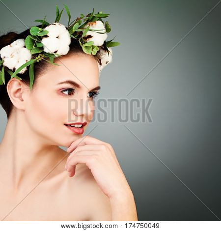Beautiful Spa Model with Healty Clean Skin and Cotton Flowers Wreath