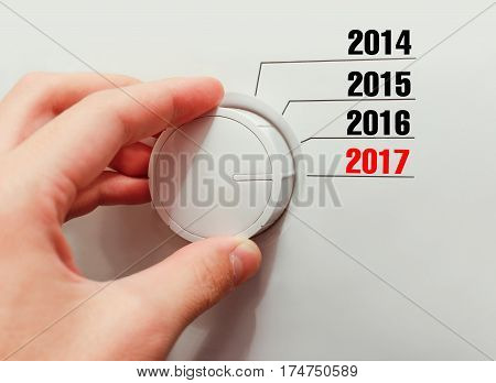 Male Hand Turns The Switch. Switches Years. Includes A New 2017 Year.