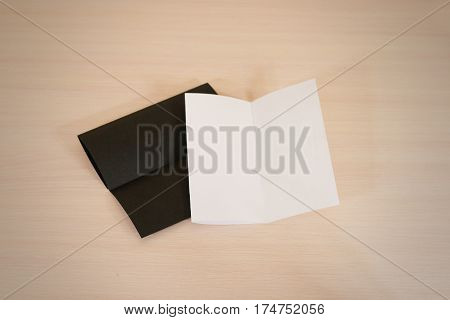 Leaflet Blank Two Flyers. White And Black Paper Brochure Mockup On A Wooden Table. Leaflet Blank Whi