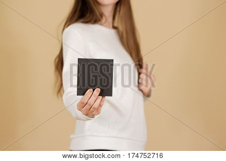 Girl Showing Blank Black Square Flyer Brochure Booklet. Leaflet Presentation. Pamphlet Hold Hands. W