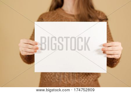 Girl Holding White Blank Paper Horizontally. Leaflet Presentation. Pamphlet Hold Hands. Woman Show C