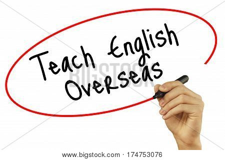 Man Hand Writing Teach English Overseas With Black Marker On Visual Screen. Isolated On Background.