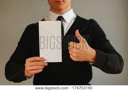 Business Man Showing Blank White Flyer Brochure Booklet And Thumb Up. Leaflet Presentation. Pamphlet