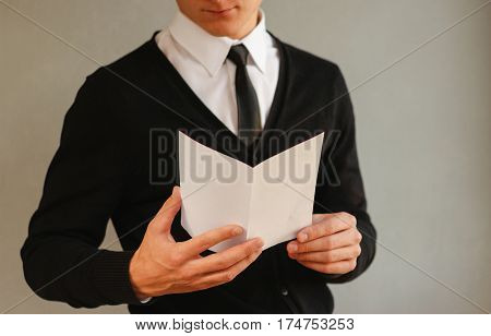 Business Man Showing Blank White Flyer Brochure Booklet. Leaflet Presentation. Pamphlet Hold Hands.