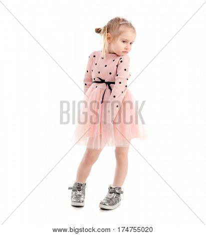 Cute girl spinning around, wearning pink polkadot shirt and skirt, lovely shoes, isolated