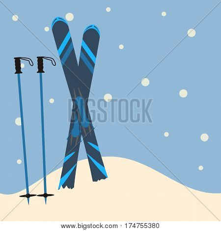 blue skis and ski poles standing in snow