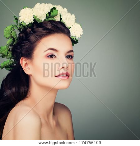 Young Brunette Model Woman with Prom Hairstyle Makeup and Flowers Wreath on Banner Background