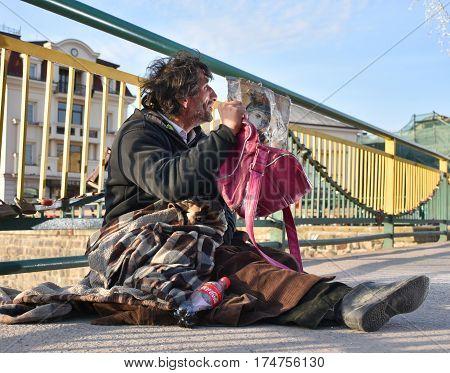 Uzhgorod,ukraine - March 04, 2017: Poor Man Begging For Alms In The Street Of Uzhhorod, Ukraine.