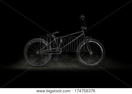 BMX bike on black background with smoke