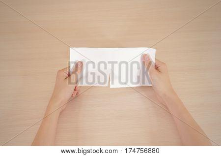 Hands Tearing A Piece Of Paper In Half Blank White Flyer Brochure Booklet. Leaflet Presentation. Pam