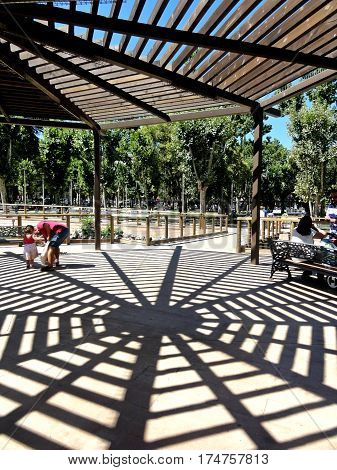 Park with arbor, shadows and contrasts alive