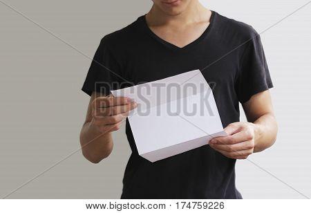 Man reading blank white flyer brochure booklet. Leaflet presentation. Pamphlet hold hands. Man show clear offset paper. Sheet template.