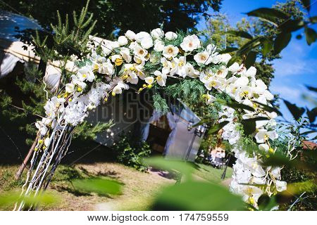 wedding arch outdoors. Horizontal photo with free space area for text or design.