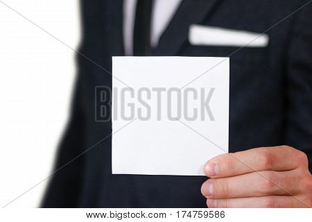 Businessman Show Square White Paper, Closeup. Showing Blank Flyer Brochure Booklet. Pamphlet Hold Ha