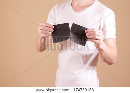 Man Tearing A Piece Of Paper In Half Blank Black Flyer Brochure Booklet. Leaflet Presentation. Pamph