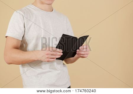 Man Showing Blank Black Flyer Brochure. Read Booklet. Leaflet Presentation. Pamphlet Hold Hands. Man