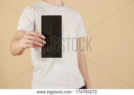 Man Showing Blank Black Flyer Brochure Booklet. Leaflet Presentation. Pamphlet Hold Hands. Man Show