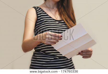 Girl Reading Blank White Flyer Brochure Booklet. Leaflet Presentation. Pamphlet Hold Hands. Woman Sh