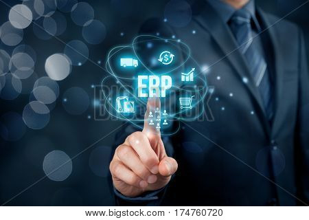 Enterprise resource planning ERP concept. Businessman click on ERP business management software button for collect store manage and interpret business data about customers HR production logistics financials and marketing.