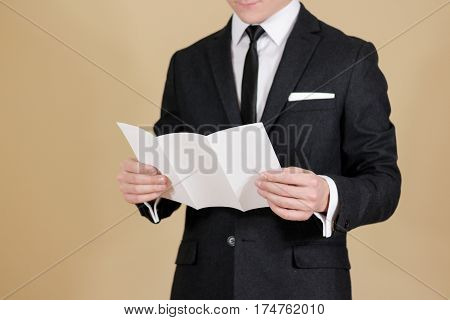 Man Showing Blank Black Flyer Brochure. Read Detailed Booklet. Leaflet Presentation. Pamphlet Hold H