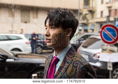 MILAN ITALY - FEBRUARY 24: Fashionable man poses outside Etro fashion show during Milan Women's Fashion Week on FEBRUARY 24 2017 in Milan.
