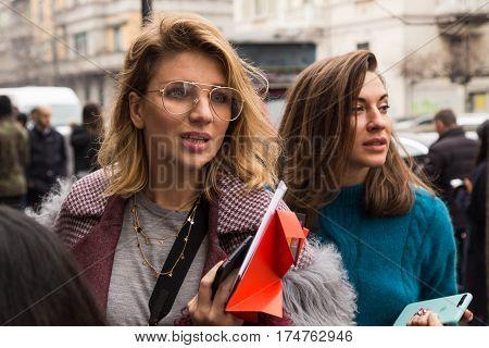 MILAN ITALY - FEBRUARY 24: Fashionable woman poses outside Etro fashion show during Milan Women's Fashion Week on FEBRUARY 24 2017 in Milan.